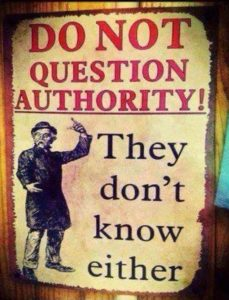 "A sign that says ""Do not question authority! They don't know either."""