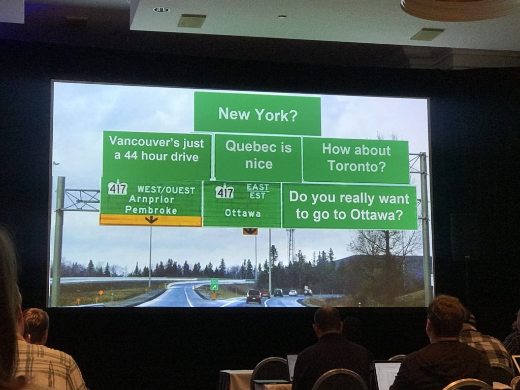 A totally fake highway sign that offers the user the choice between route 417 East and West in Canada initially, but also adds signs for Vancouver being 44 hours away, Quebec is Nice, Do you really want to go to Ottawa?, how about toronto? new york?